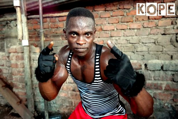 Click to enlarge image kope-uganda-boxing-rhino1.jpg
