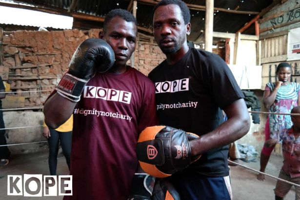Click to enlarge image kope-uganda-boxing-rhino4.jpg