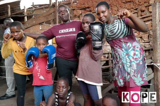 Click to enlarge image kope-uganda-boxing-rhino3.jpg